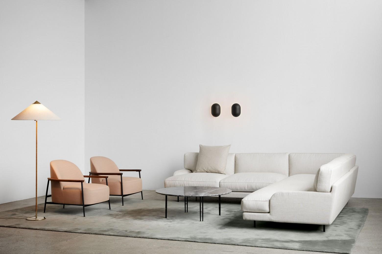 Photo de gauche: Séjour avec accoudoir Victors Design Agency